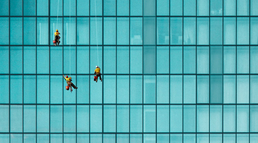 Window cleaners on a large building