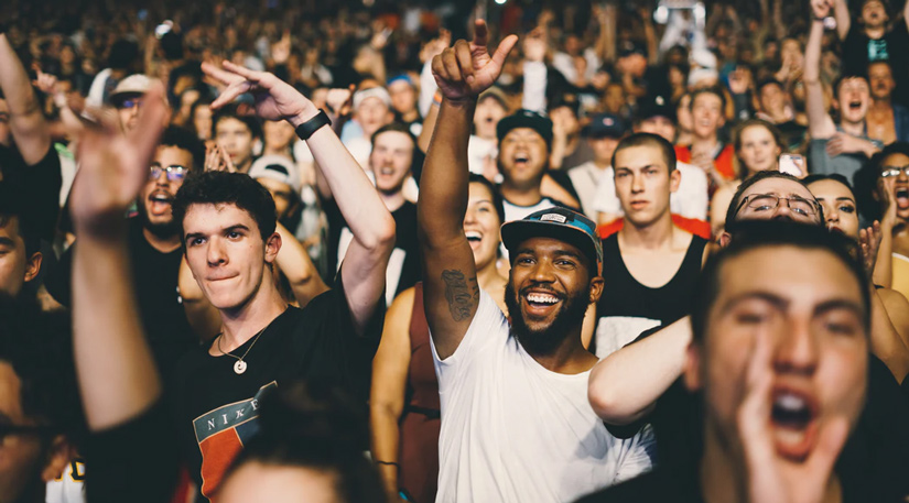 People cheering in a crowd