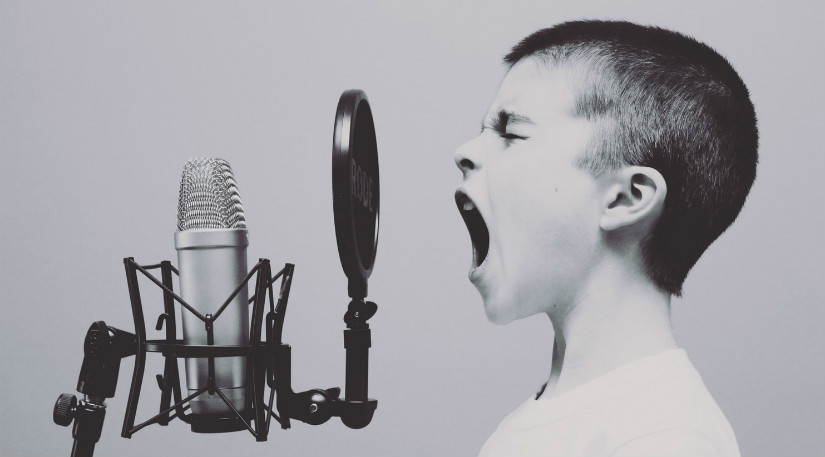A kid shouting into a mic
